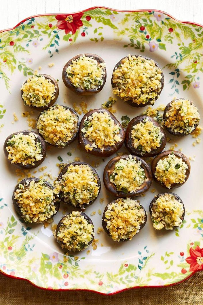 """<p>Perfectly crispy and creamy in very bite—these mushrooms are stuffed with melty brie cheese, then covered in a crunchy panko topping. </p><p><a href=""""https://www.thepioneerwoman.com/food-cooking/recipes/a34208011/crispy-brie-stuffed-mushrooms-recipe/"""" rel=""""nofollow noopener"""" target=""""_blank"""" data-ylk=""""slk:Get Ree's recipe."""" class=""""link rapid-noclick-resp""""><strong>Get Ree's recipe.</strong></a></p>"""