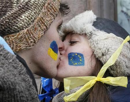 Students kiss as they stand on a street to form a human chain from the Ukrainian capital to the western border during a demonstration in Kiev