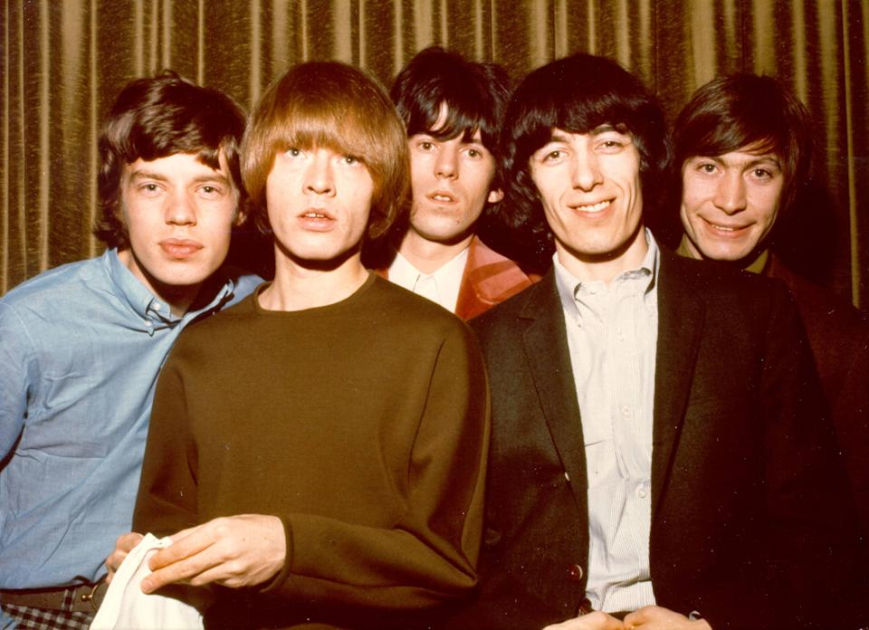 The Rolling Stones pose for a portrait in 1964. (L-R) Mick Jagger, Brian Jones, Keith Richards, Bill Wyman, Charlie Watts. (Getty)