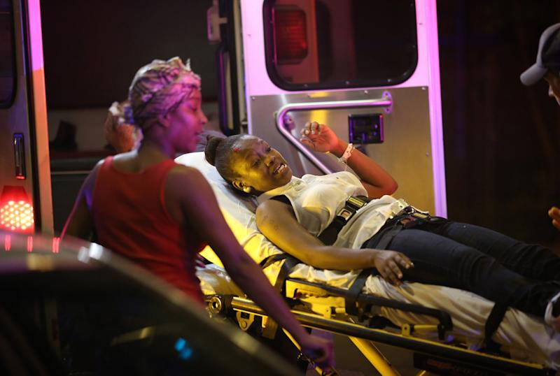 Emergency personnel transport victims from the scene where 12 people, including a 3-year-old, were shot at Cornell Square Park in the Back of the Yards neighborhood in Chicago, September 19, 2013. (Photo: E. Jason Wambsgans/Chicago Tribune/MCT via Getty Images)