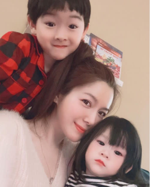 Christine dots on her cute niece and nephew