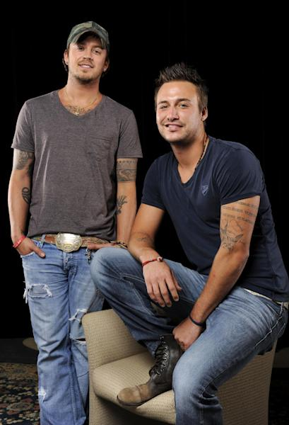 This July 11, 2012 photo shows country music duo Love and Theft, Stephen Barker Liles, left, and Eric Gunderson in Nashville, Tenn. Gunderson, 27, and Liles, 28, have a self-titled second album, which came out last week. (Photo by Donn Jones/Invision/AP)
