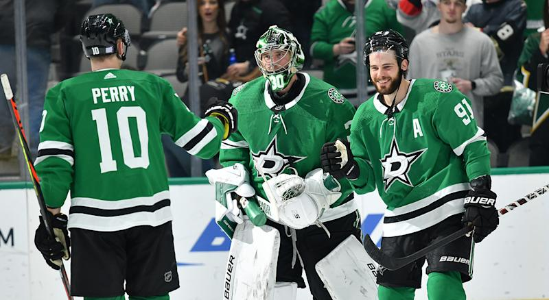 DALLAS, TX - NOVEMBER 25: Ben Bishop #30 of the Dallas Stars is congratulated on a win against the Vegas Golden Knights at the American Airlines Center on November 25, 2019 in Dallas, Texas. (Photo by Glenn James/NHLI via Getty Images)