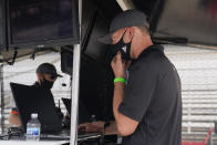 Cole Pearn looks at information on his computer screen for the Conor Daly car during a practice session for the Indianapolis 500 auto race at Indianapolis Motor Speedway, Thursday, Aug. 13, 2020, in Indianapolis. (AP Photo/Darron Cummings)