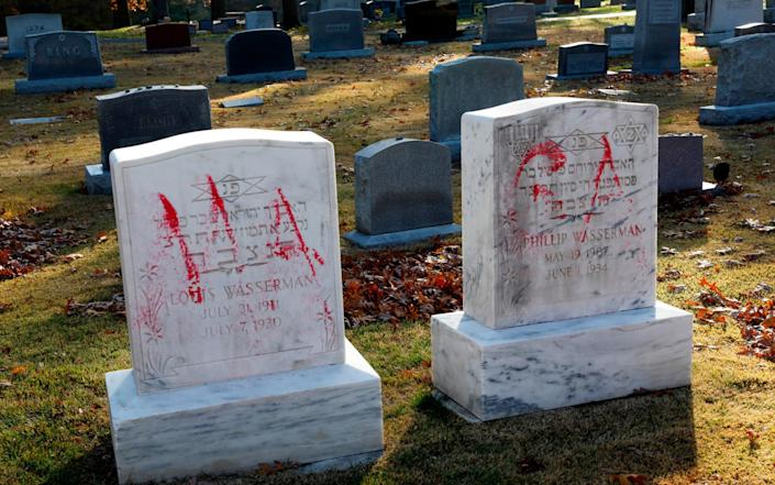 Pro-Trump messages that are spray-painted on grave stones are viewed at Ahavas Israel Cemetery in Grand Rapids, Michigan - JEFF KOWALSKY /AFP