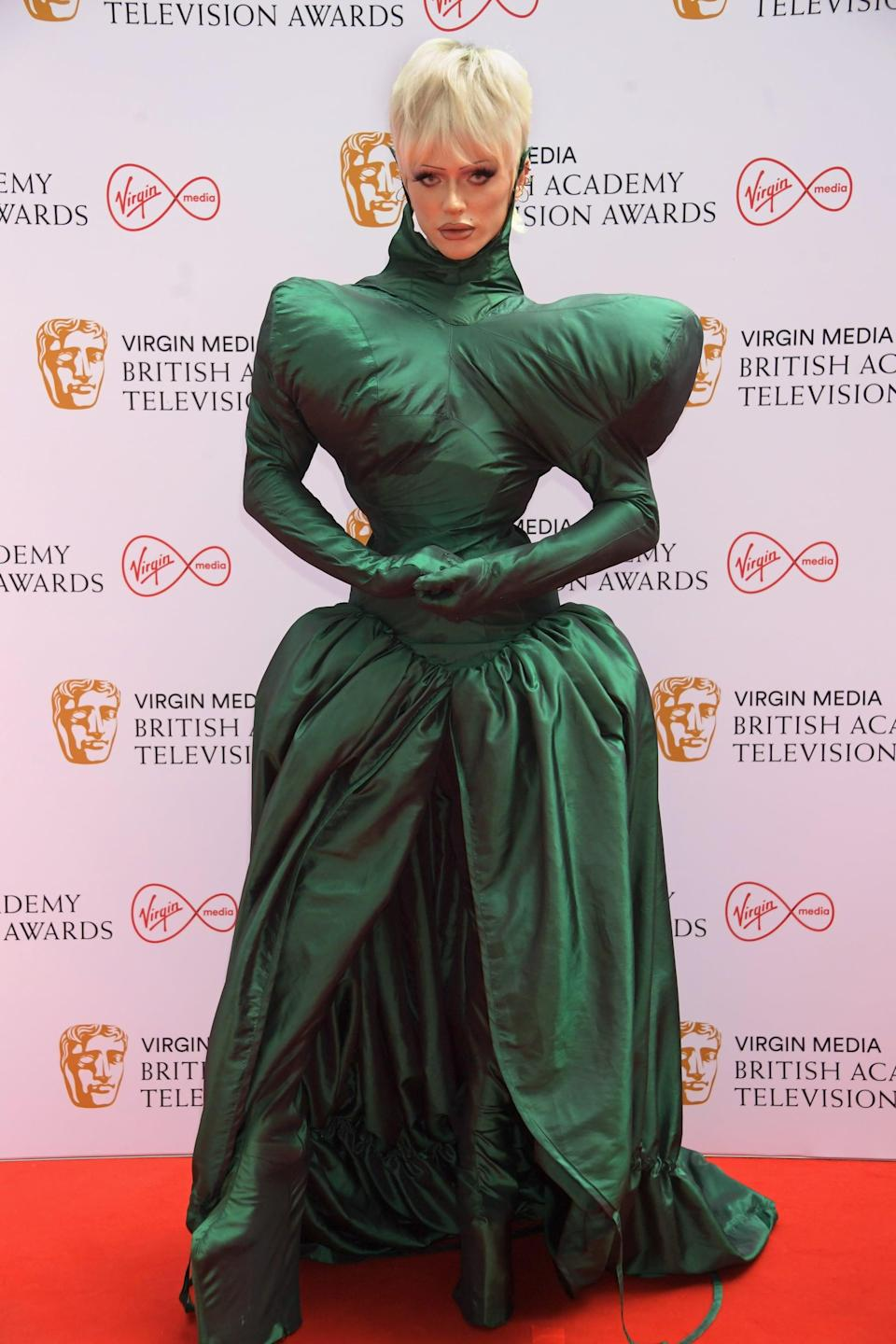 <p>Bimini Bon Boulash wore an emerald gown with exaggerated proportions created by Central Saint Martins students Ása Bríet Brattaberg, Dem James Erik Paris, and Kitty Hemmings. </p>