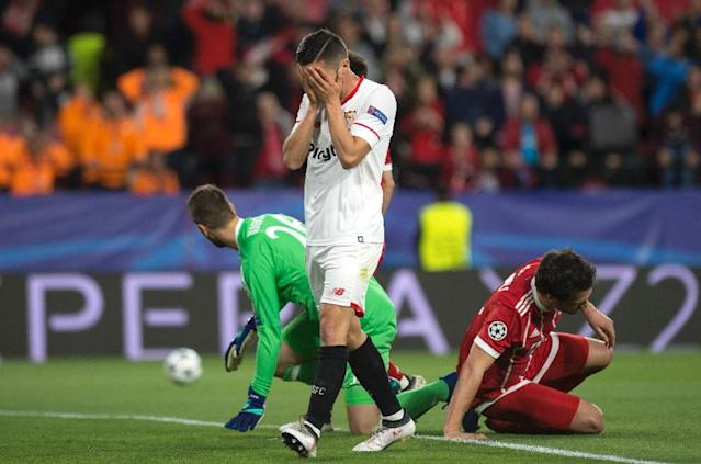 Sevilla's Spanish midfielder Pablo Sarabia covers his face during the UEFA Champions League quarter-final first leg football match between Sevilla FC and Bayern Munich at the Ramon Sanchez Pizjuan Stadium in Sevilla on April 3, 2018. (AFP Photo/Jorge GUERRERO)