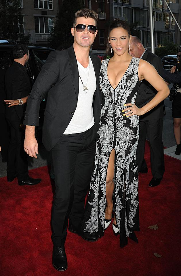 """Actress Paula Patton arrives on the red carpet with her husband Robin Thicke for the World Premiere of her new film """"2 Guns"""" presented by Universal Pictures and Emmett/Furla Films held at the School of Visual Arts (SVA) Theatre in Chelsea in NYC. Pictured: Robin Thicke and Paula Patton Ref: SPL585870  290713  Picture by: Johns PKI / Splash News   Splash News and Pictures Los Angeles:310-821-2666 New York:212-619-2666 London:870-934-2666 photodesk@splashnews.com"""