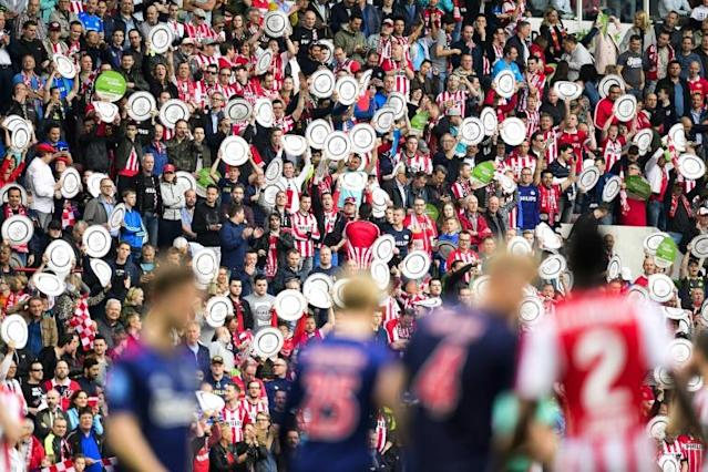 PSV Eindhoven fans celebrate their team's Dutch title triumph with replicas of the league trophy