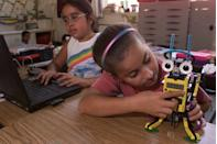 """<p>Two fourth grade students build and program a robot that throws balls of paper for robotics class.</p><p><strong>RELATED: </strong><a href=""""https://www.goodhousekeeping.com/childrens-products/g5162/best-stem-toys/"""" rel=""""nofollow noopener"""" target=""""_blank"""" data-ylk=""""slk:The Best STEM Toys for Kids"""" class=""""link rapid-noclick-resp"""">The Best STEM Toys for Kids</a></p>"""