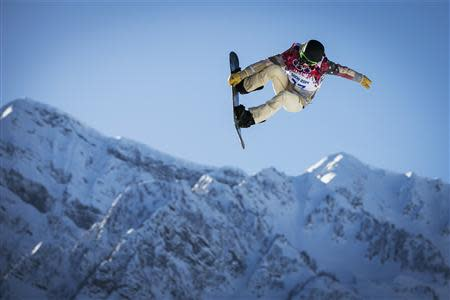 U.S. snowboarder Shaun White goes off a jump during snowboard slopestyle training at the 2014 Sochi Winter Olympics in Rosa Khutor February 4, 2014. REUTERS/Lucas Jackson