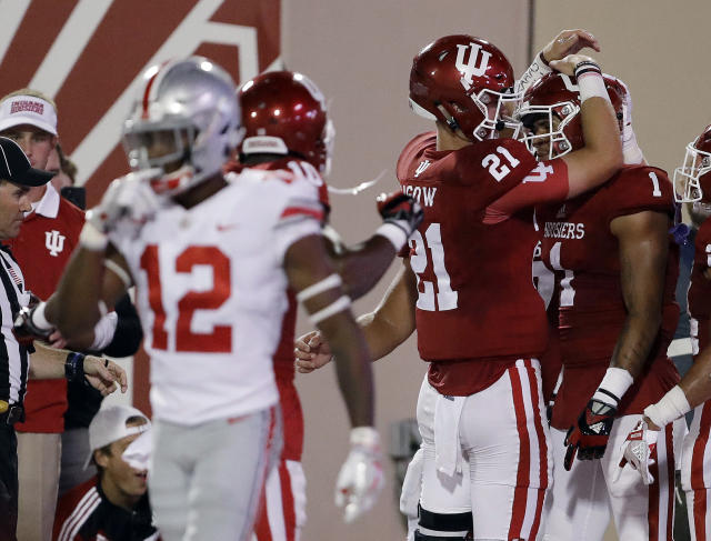 "Indiana quarterback <a class=""link rapid-noclick-resp"" href=""/ncaaf/players/227529/"" data-ylk=""slk:Richard Lagow"">Richard Lagow</a> (21) celebrates an 8-yard touchdown reception by wide receiver <a class=""link rapid-noclick-resp"" href=""/ncaaf/players/244393/"" data-ylk=""slk:Simmie Cobbs Jr."">Simmie Cobbs Jr.</a> (1) during the first half against Ohio State. (AP Photo/Darron Cummings)"