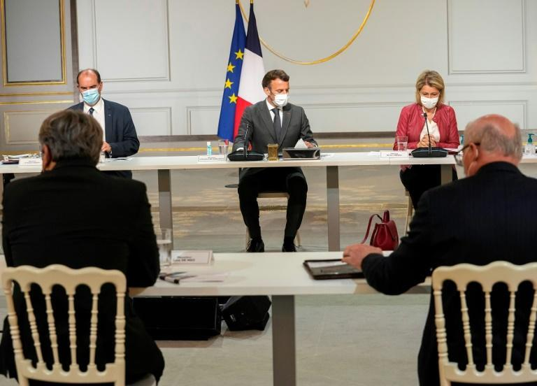 France's Emmanuel Macron hosted several meetings before his expected evening address to the nation
