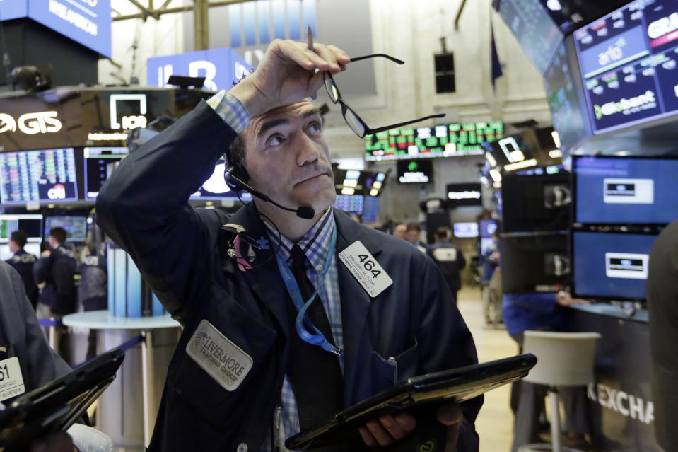 FILE- In this Aug. 28, 2018, file photo trader Gregory Rowe works on the floor of the New York Stock Exchange. The bull market for U.S. stocks is now 10 years old and the longest since World War II. That lifespan speaks to financial markets' resiliency in the face of a variety of shocks, including a brutal fourth quarter of 2018.  (AP Photo/Richard Drew, File)