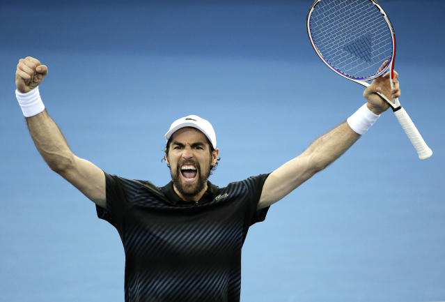 Jeremy Chardy of France reacts after winning his quarter final match against Yasutaka Uchiyama of Japan at the Brisbane International tennis tournament in Brisbane, Australia, Thursday, Jan. 3, 2019. (AP Photo/Tertius Pickard)