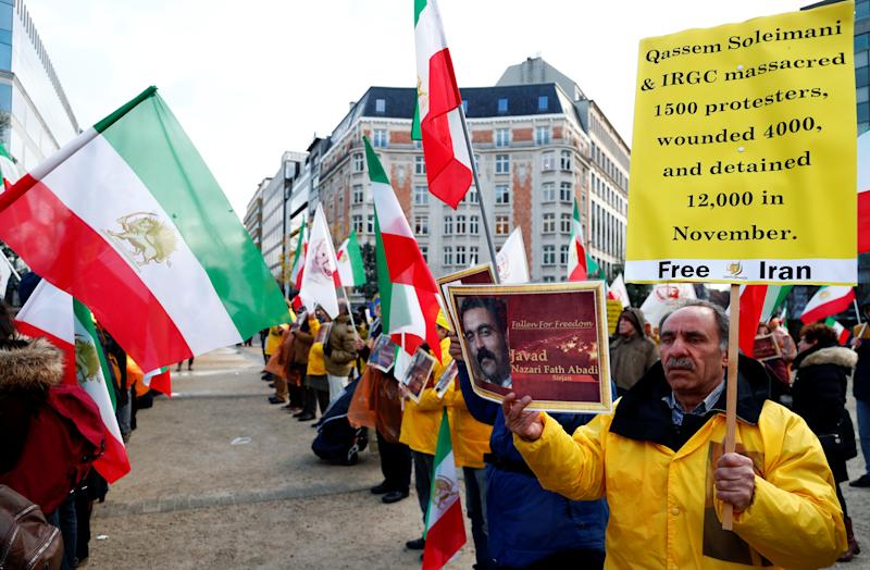 Supporters of the National Council of Resistance of Iran (NCRI) protest as European Union foreign ministers attend an emergency meeting in Brussels