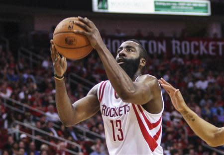 Apr 4, 2014; Houston, TX, USA; Houston Rockets guard James Harden (13) drives the ball to the basket during the second quarter against the Oklahoma City Thunder at Toyota Center. Mandatory Credit: Troy Taormina-USA TODAY Sports