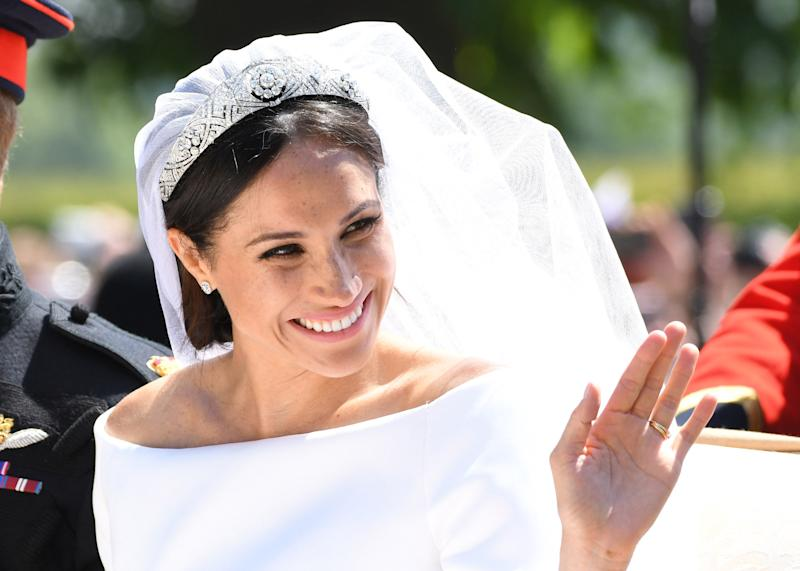 WINDSOR, ENGLAND - MAY 19: Meghan, Duchess of Sussex leaves Windsor Castle in the Ascot Landau carriage during a procession after getting married at St Georges Chapel on May 19, 2018 in Windsor, England. Prince Henry Charles Albert David of Wales marries Ms. Meghan Markle in a service at St George's Chapel inside the grounds of Windsor Castle. Among the guests were 2200 members of the public, the royal family and Ms. Markle's mother, Doria Ragland. (Photo by Karwai Tang/WireImage)