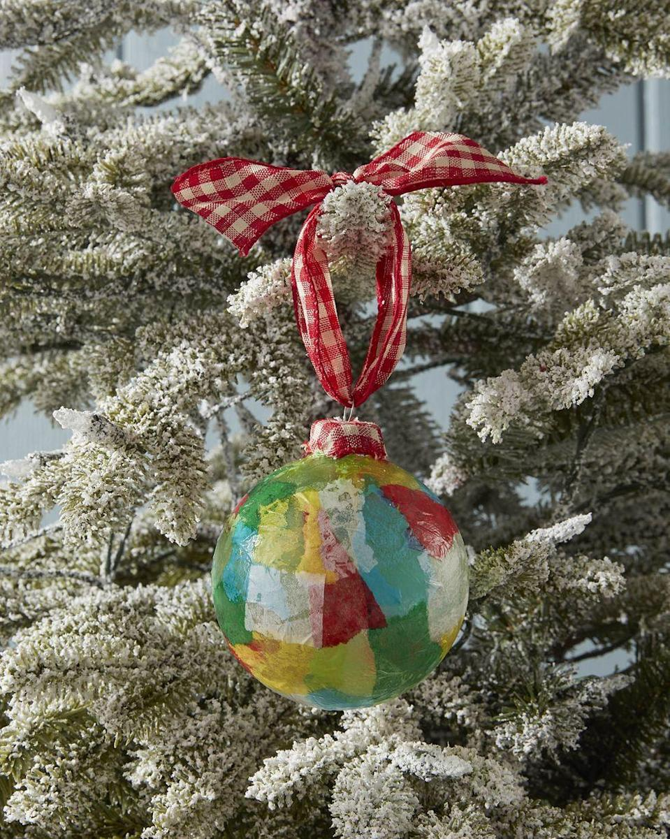 """<p>Decoupage, the art of decorating things by gluing colored paper cutouts onto it, makes this ornament as much fun to create as it is to receive.</p><p><strong>To make:</strong> Tear colorful tissue paper into small pieces. Attach to a clear glass or plastic ball ornament with glossy Mod Podge. Attach a small piece of ribbon or fabric over the ornament cap. Hang to dry.</p><p><a class=""""link rapid-noclick-resp"""" href=""""https://www.amazon.com/Darice-2610-42-6-Piece-Heavy-Glass/dp/B002Z1WFVE/ref=sr_1_1_sspa?tag=syn-yahoo-20&ascsubtag=%5Bartid%7C10050.g.645%5Bsrc%7Cyahoo-us"""" rel=""""nofollow noopener"""" target=""""_blank"""" data-ylk=""""slk:SHOP GLASS ORNAMENTS"""">SHOP GLASS ORNAMENTS</a></p>"""