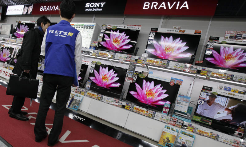 In this March 2, 2012 photo, a visitor inspects Sony's flat panel TVs at a retail store in Tokyo. Sony Corp. now has a new president - Kazuo Hirai, the former head of its game division. But shareholders are already raising doubts about his ability to revive the Japanese electronics and entertainment giant. (AP Photo/Koji Sasahara)