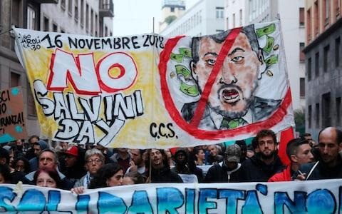 Anti Salvini protestors in Milan march in support of Domenico Lucano, a mayor in southern Italy jailed for allegedly helping illegal immigration - Credit:  Matteo Bazzi/ANSA