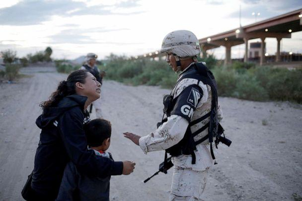 PHOTO: Guatemalan migrant Lety Perez embraces her son Anthony while asking a member of the Mexican National Guard to let them cross into the United States, as seen from Ciudad Juarez, Mexico July 22, 2019. (Jose Luis Gonzalez/Reuters)
