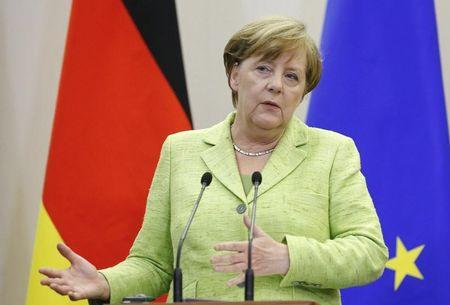 German Chancellor Merkel speaks during joint news conference with Russian President Putin following their talks at Bocharov Ruchei state residence in Sochi
