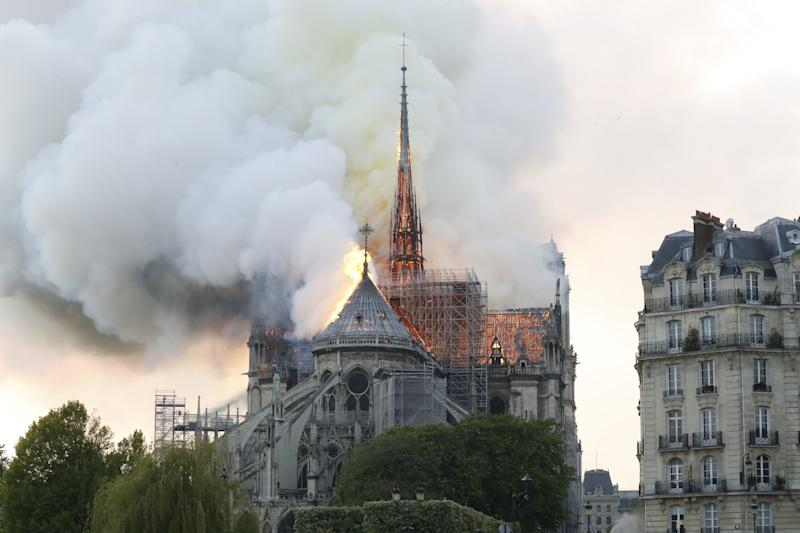 Plumes of smoke and flames rise during a fire at the landmark Notre-Dame Cathedral in central Paris on April 15, 2019, potentially involving renovation works being carried out at the site, the fire service said. (Photo: Francois Guillot/AFP/Getty Images)