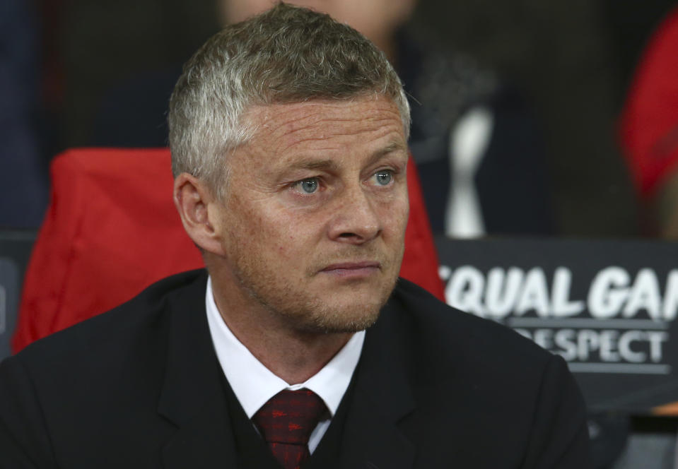 Manchester United's manager Ole Gunnar Solskjaer watches ahead of the Europa League Group L soccer match between Manchester United and Astana at Old Trafford stadium in Manchester, England Thursday, Sept. 19, 2019. (AP Photo/Dave Thompson)