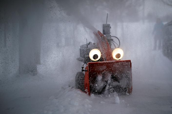 """""""Chomper,"""" a semi-autonomous, GPS-guided snow blower designed and built by MIT research engineer Dane Kouttron, clears snow following an overnight storm in Cambridge, Massachusetts, U.S., February 28, 2019."""