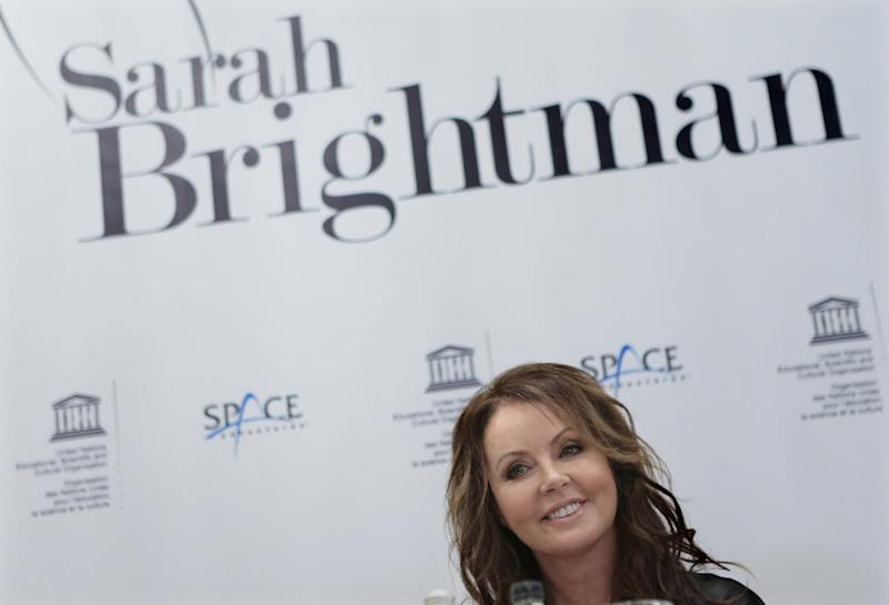 British singer Sarah Brightman smiles during news conference in Moscow, Russia, Wednesday, Oct. 10, 2012. Brightman is to become the first-ever global recording artist to take a spaceflight, teaming up with Space Adventures for a journey to the International Space Station (ISS). (AP Photo/Mikhail Metzel)