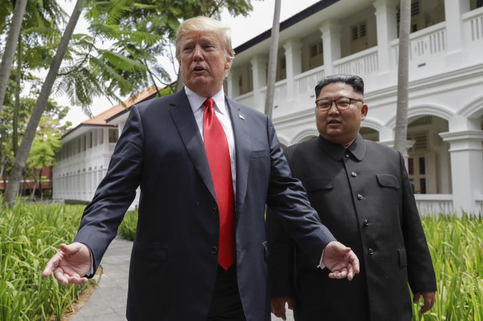 President Trump and North Korean leader Kim Jong Un talk with the media as they walk from their lunch at the Capella resort on Sentosa Island in Singapore on Tuesday. (Photo: Evan Vucci/AP)