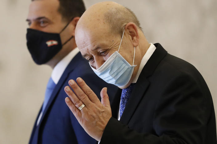 French Foreign Minister Jean-Yves Le Drian salutes journalists as he leaves the Presidential Palace after his meeting with Lebanese President Michel Aoun, in Baabda, east of Beirut, Lebanon, Thursday, May 6, 2021. Le Drian is in Beirut for two days visit to meet with Lebanese officials. (AP Photo/Hussein Malla)