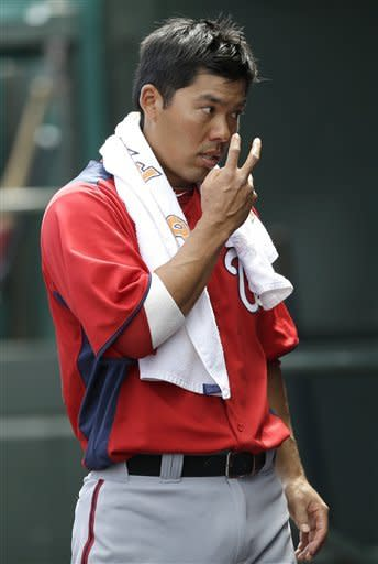 Washington Nationals' Kurt Suzuki gestures toward pitcher Gio Gonzalez while in the dugout during the second inning of an exhibition spring training baseball game against the St. Louis Cardinals, Saturday, March 2, 2013, in Jupiter, Fla. (AP Photo/Julio Cortez)