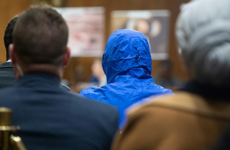 A Syrian military defector using the pseudonym Caesar, wearing a hood to protect his identity, testifies about the war in Syria before the Senate Foreign Relations Committee