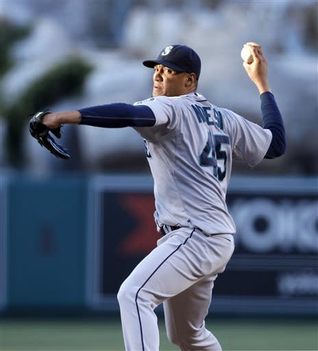 Seattle Mariners starting pitcher Hector Noesi throws during the first inning of a baseball game against the Los Angeles Angels in Anaheim, Calif., on Wednesday, June 6, 2012. (AP Photo/Christine Cotter)