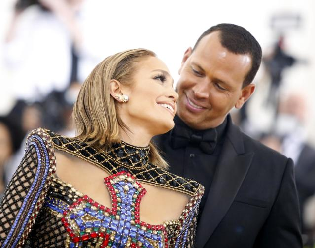 "Singer Jennifer Lopez and baseball personality Alex Rodriguez arrive at the Metropolitan Museum of Art Costume Institute Gala (Met Gala) to celebrate the opening of ""Heavenly Bodies: Fashion and the Catholic Imagination"" in the Manhattan borough of New York, U.S., May 7, 2018. REUTERS/Eduardo Munoz"