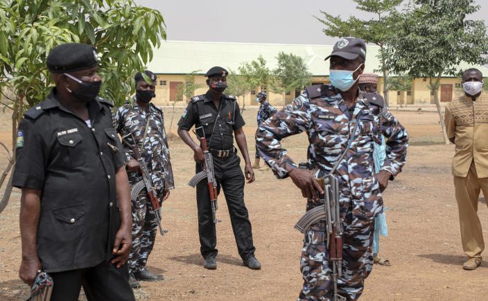 Security forces guard the Government Girls Junior Secondary School where more than 300 girls were abducted by gunmen on Friday, in Jangebe town, Zamfara state, northern Nigeria Sunday, Feb. 28, 2021. Families in Nigeria waited anxiously on Sunday for news of their abducted daughters, the latest in a series of mass kidnappings of school students in the West African nation. (AP Photo/Ibrahim Mansur)