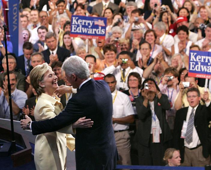 <p>Former President Bill Clinton hugs his wife, Sen. Hillary Clinton, as she introduces him during the Democratic National Convention at the FleetCenter in Boston on July 26, 2004. (Photo: Kevork Djansezian/AP)</p>