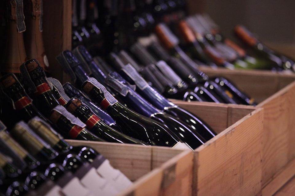Red wine bottles in cases.