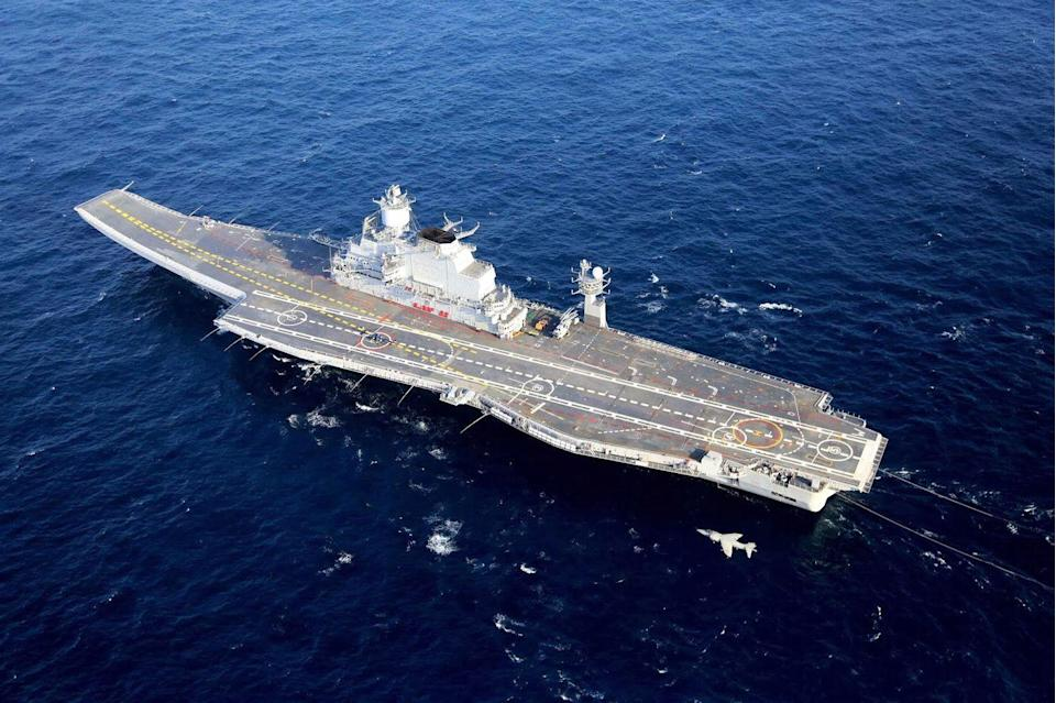 "<p>The first of India's two carriers, <em>Viraat</em>, is an ex-British light aircraft carrier that was until recently the flagship of the Indian Navy. Built during World War II, she is the oldest serving aircraft carrier in the world. Displacing 28,700 tons and 741 feet long, <em>Viraat</em> can carry nine Indian Navy Sea Harrier fighters and 15 Sea King, Helix, and <a href=""https://en.wikipedia.org/wiki/Aérospatiale_Alouette_III"" rel=""nofollow noopener"" target=""_blank"" data-ylk=""slk:Chetak"" class=""link rapid-noclick-resp"">Chetak</a> helicopters. </p><p>The Indian Navy's new flagship is the carrier <em>Vikramaditya</em> (pictured). Formerly a Soviet ship used for anti-submarine warfare, <em>Vikramaditya</em> was fitted with an angled flight deck, given a 14-degree ski jump, and extensively modernized. Completed, she's 930 feet long and displaces 45,000 tons.</p><p><em>Vikramaditya</em> has a powerful air wing consisting of 36 <a href=""https://en.wikipedia.org/wiki/Mikoyan_MiG-29K"" rel=""nofollow noopener"" target=""_blank"" data-ylk=""slk:MiG-29K multi-role fighters"" class=""link rapid-noclick-resp"">MiG-29K multi-role fighters</a>—modernized versions of the MiG-29 optimized for carrier operations. She also embarks 12 Helix helicopters, both for airborne early warning and control and search-and-rescue operations.</p><p>A replacement for the <em>Viraat</em>, <em>Vikrant</em>, is currently under construction and will be India's first locally designed and built carrier. Indian Navy Chief Admiral Karambir Singh <a href=""https://www.indiatoday.in/india/story/navy-to-press-for-3rd-aircraft-carrier-admiral-karambir-singh-says-it-s-necessary-for-an-aspirational-nation-1746369-2020-12-03"" rel=""nofollow noopener"" target=""_blank"" data-ylk=""slk:recently said"" class=""link rapid-noclick-resp"">recently said</a> he plans to make the case for a third aircraft carrier..</p>"