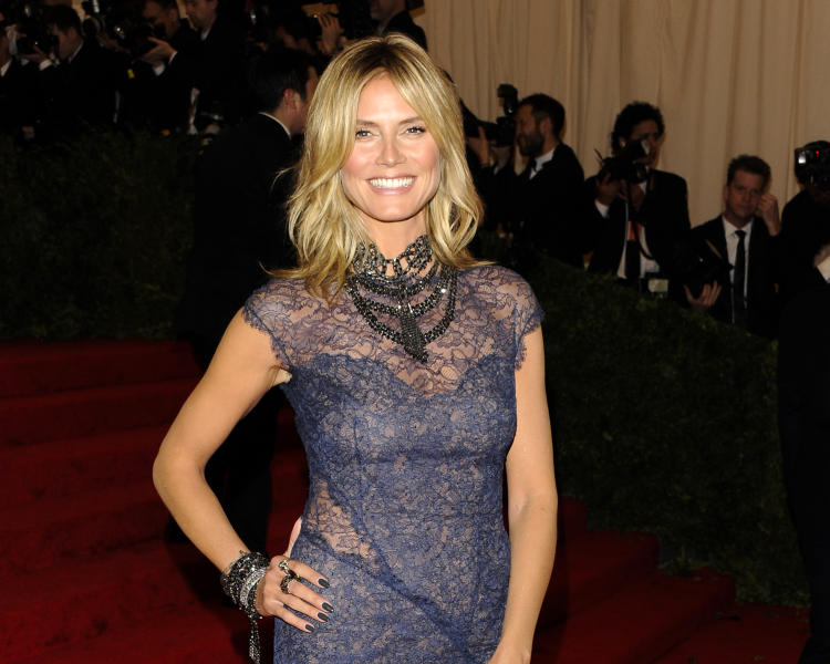 "FILE - This May 7, 2012 file photo shows model and TV host Heidi Klum arriving at the Metropolitan Museum of Art Costume Institute gala benefit in New York. Klum is denying that she had an affair with her bodyguard while married to pop singer Seal. But now, having split from Seal, she says she is seeing the bodyguard. On Wednesday's edition of the Katie Couric talk show, Klum said she ""never looked at another man"" while she and Seal were together. But more recently, she and the family's bodyguard of four years have gotten to know each other ""from a completely different side."" (AP Photo/Evan Agostini, file)"