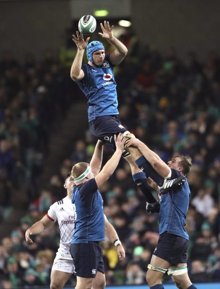 FILE - In this file photo dated Saturday, Nov 24, 2018, Ireland's Tadhg Beirne, top, wins a line out against the USA during their Rugby Union International at the Aviva Stadium, Dublin, Ireland. Ireland lock Tadhg Beirne will get his Six Nations Debut when Ireland meet Wales for the deciding match upcoming Saturday March 16, 2019, with Ireland pressing for its Six Nations Grand Glam. (AP Photo/Peter Morrison, FILE)