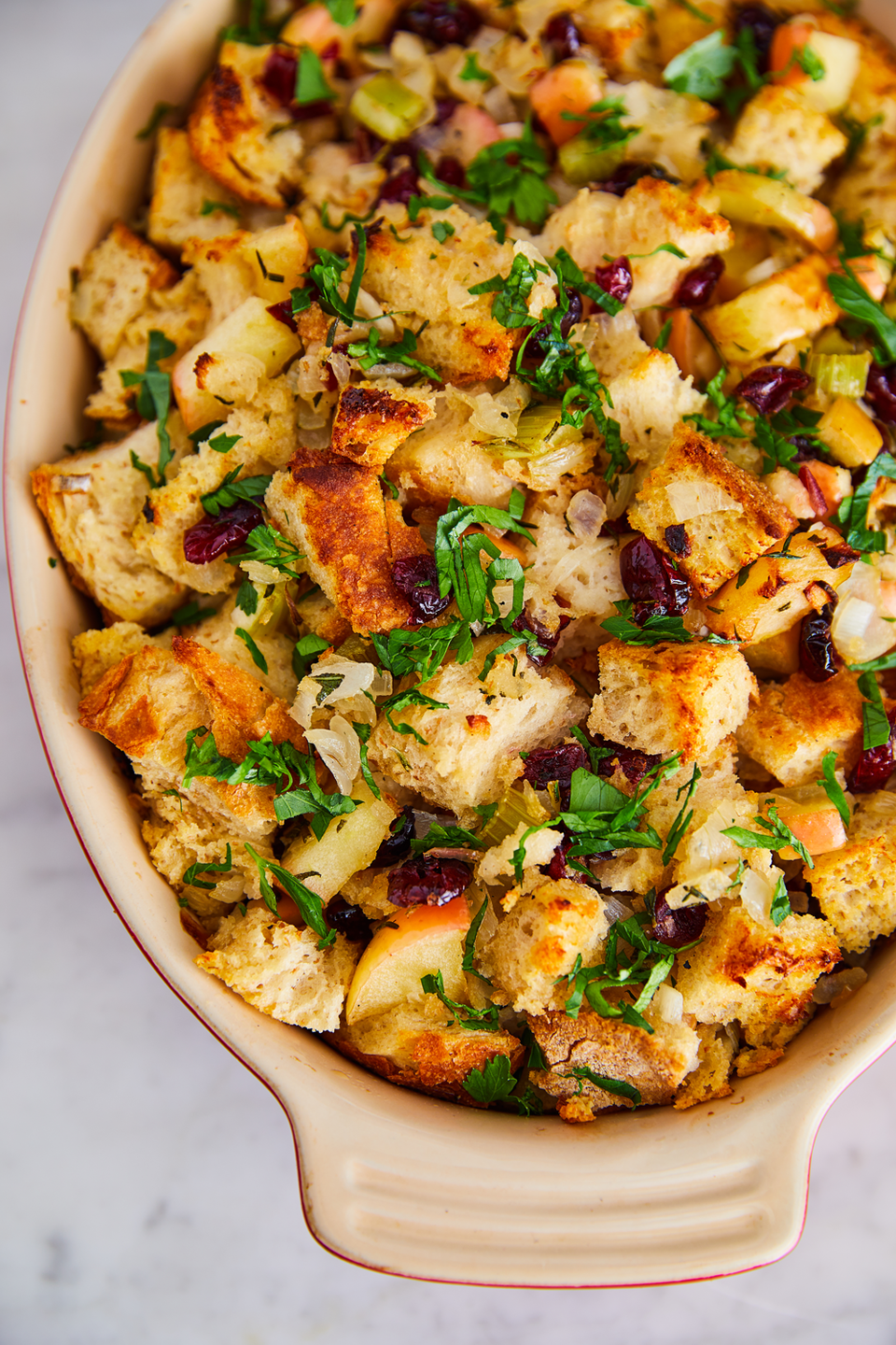 "<p>You don't need sausage to make a stuffing everyone will love. </p><p>Get the recipe from <a href=""https://www.delish.com/holiday-recipes/thanksgiving/a22628293/easy-cranberry-stuffing-recipe/"" rel=""nofollow noopener"" target=""_blank"" data-ylk=""slk:Delish"" class=""link rapid-noclick-resp"">Delish</a>.</p>"