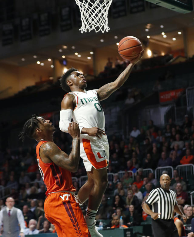 Miami guard Chris Lykes (0) goes up for a shot against Virginia Tech guard Ahmed Hill during the first half of an NCAA college basketball game Wednesday, Jan. 30, 2019, in Coral Gables, Fla. (AP Photo/Wilfredo Lee)