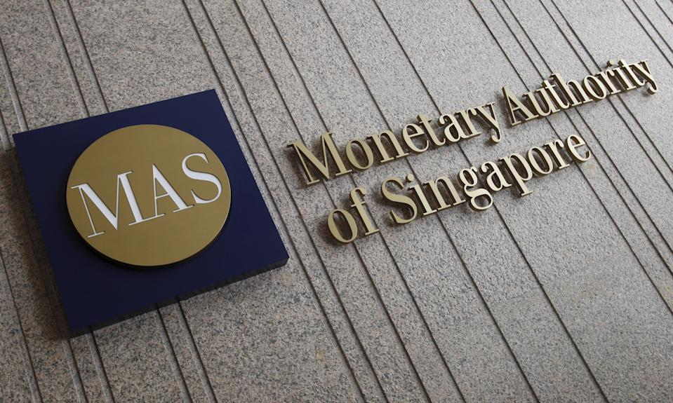 The logo of the Monetary Authority of Singapore (MAS) is pictured at its building in Singapore in this February 21, 2013 file photo.  REUTERS/Edgar Su/Files         GLOBAL BUSINESS WEEK AHEAD PACKAGE- SEARCH 'BUSINESS WEEK AHEAD APRIL 11' FOR ALL IMAGES