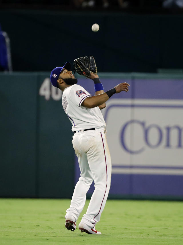 Texas Rangers' Elvis Andrus reaches up to field a fly out by Tampa Bay Rays' Joey Wendle during the fifth inning of a baseball game in Arlington, Texas, Wednesday, Sept. 11, 2019. (AP Photo/Tony Gutierrez)