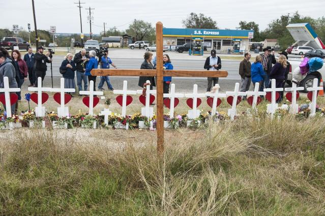The crosses, erected across the street from the church, have become a meeting ground for mourners. (Laura Schimmel/Padre Ryan Photography for HuffPost)