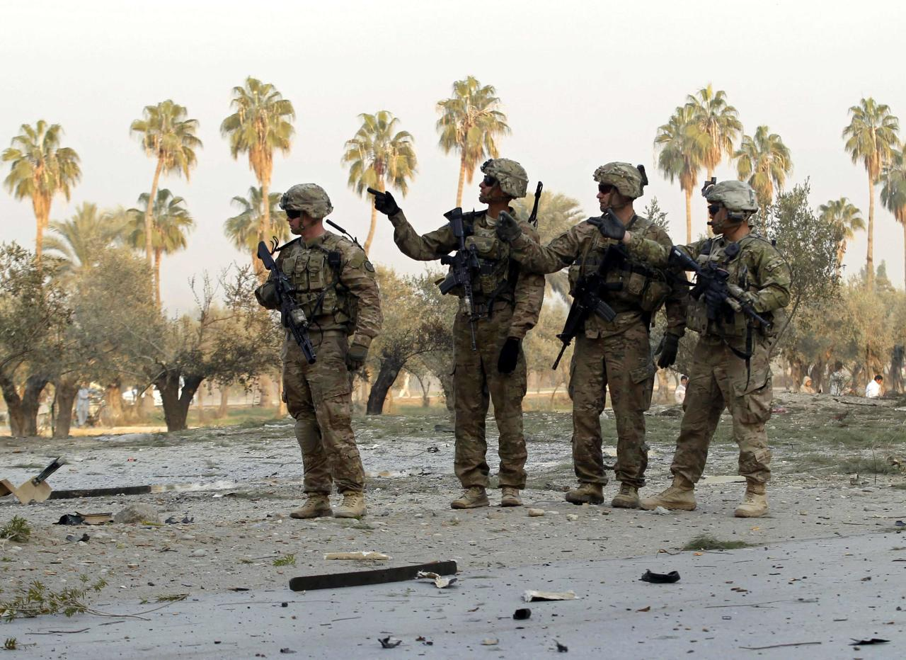 U.S. troops keep watch at the site of a suicide attack on the outskirts of Jalalabad, January 5, 2015. A suicide attacker targeted a U.S. convoy on the outskirts of Jalalabad on Monday but so far no causalities have been reported yet, provincial spokesman Ahmadzia Abdulzai said. REUTERS/Parwiz (AFGHANISTAN - Tags: CIVIL UNREST POLITICS MILITARY TPX IMAGES OF THE DAY)