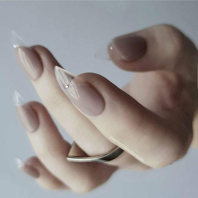 "<p>Who knew teaming nude nails with a clear acrylic stiletto tip could look so damn classy?</p><p><a href=""https://www.instagram.com/p/B7eJmieHm9B/"" rel=""nofollow noopener"" target=""_blank"" data-ylk=""slk:See the original post on Instagram"" class=""link rapid-noclick-resp"">See the original post on Instagram</a></p>"